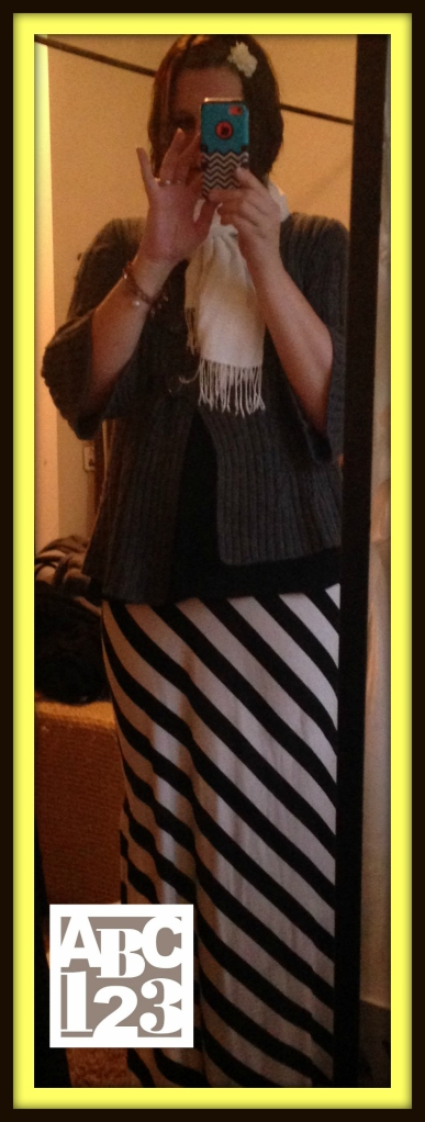 Grey Sweater from Desert Industries, Cream World Vision Scarf, Black Shirt from Desert Industries, Black & White Striped Mossimo Skirt (gift from Mom) Grey Tights from Target